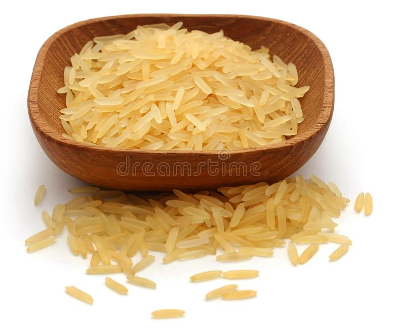 Basmati rice. In bowl over white background royalty free stock image