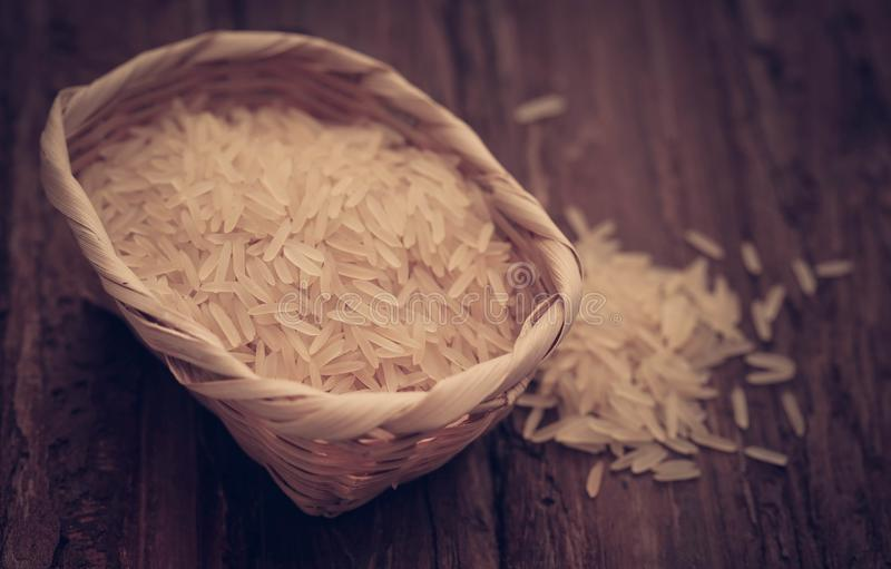 Basmati rice. Uncooked on natural surface stock image