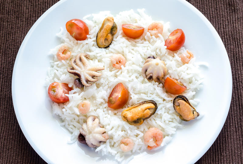 Basmati rice with seafood. On the brown background stock images