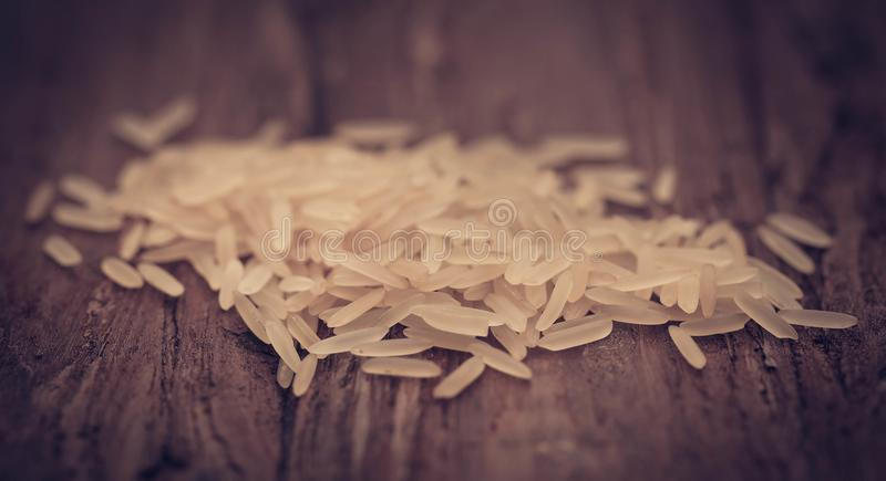 Basmati rice. Uncooked on natural surface stock photo