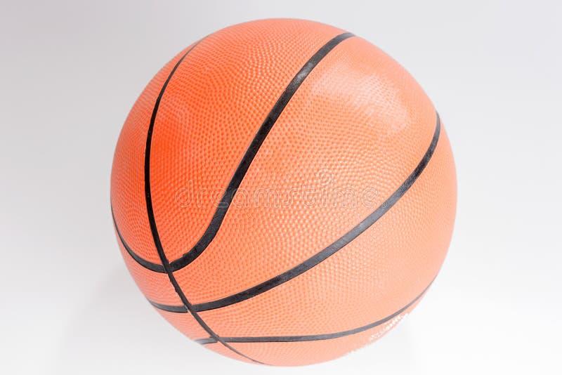 Basquetebol alaranjado da cor sobre o fundo branco foto de stock royalty free
