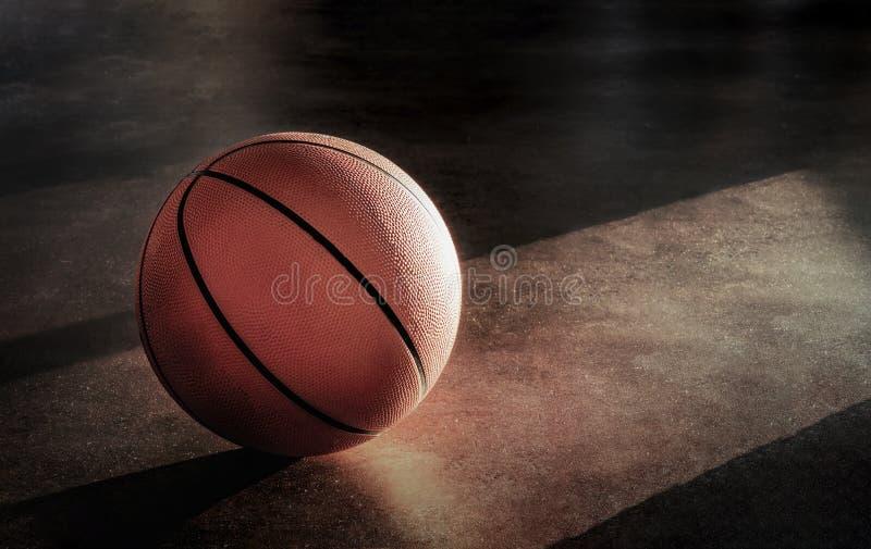 Basquetebol colocado no assoalho fotografia de stock
