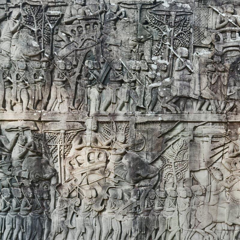 Basrelief på den Bayon templet i Angkor Thom för den cambodia för angkoren skördar banteay lotuses laken siemsreytempelet cambodi arkivbilder