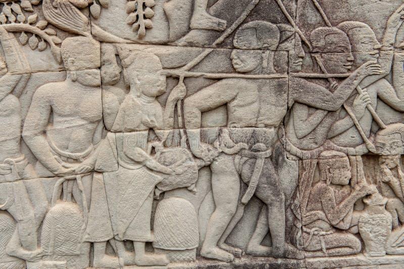 Basreliefer på Angkor Thom, Cambodja arkivfoto
