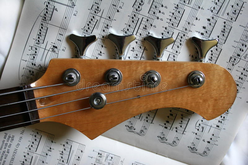 Bass guitar. Strings and pegs royalty free stock image