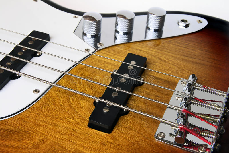 Bass Guitar. Part four string bass guitar royalty free stock photo