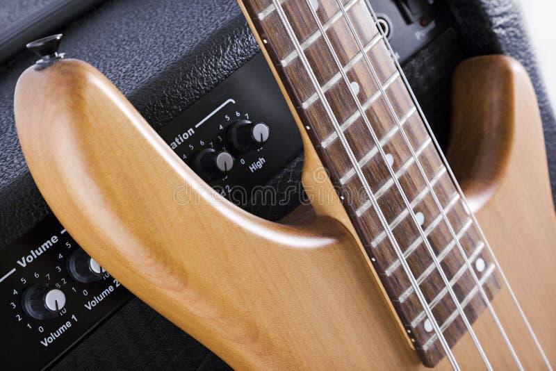 Bass guitar and amplifier stock photo