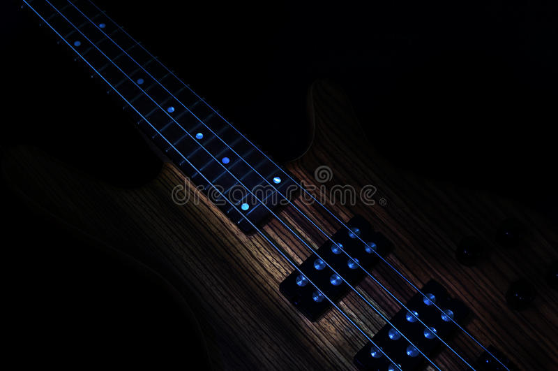 Bass Guitar Low Key royaltyfri fotografi