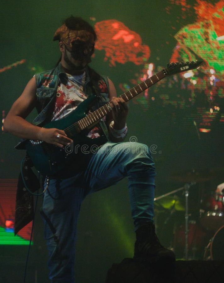 Bass guitar player with mask
