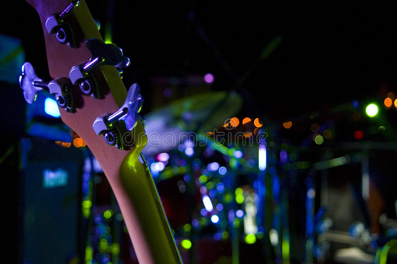 Bass guitar on the stage stock images