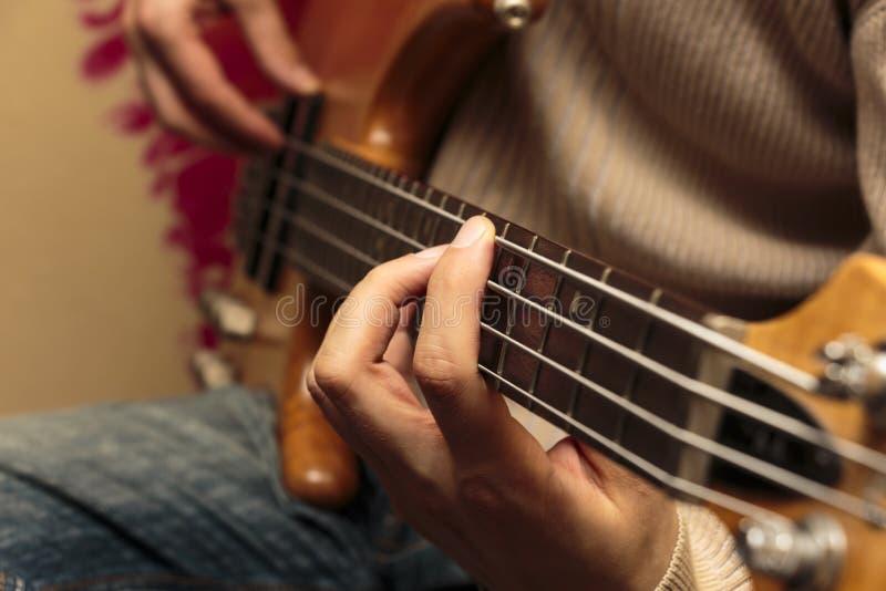 Bass Guitarist close-up stock images