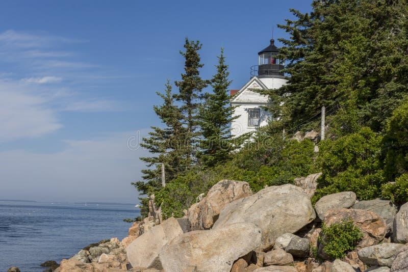 Bass Harbor light house. Bass harbor lighthouse Acadia national Park Maine USA. A horizontal photograph of Bass harbor lighthouse, summertime green trees royalty free stock photos