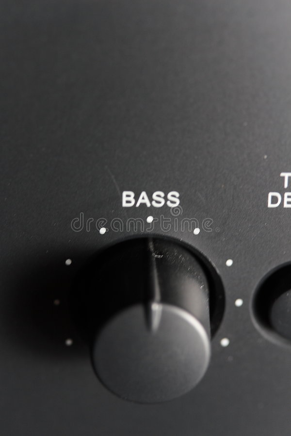 Bass Knob. A closeup view of the Bass controller knob on a stereo amplifier royalty free stock image