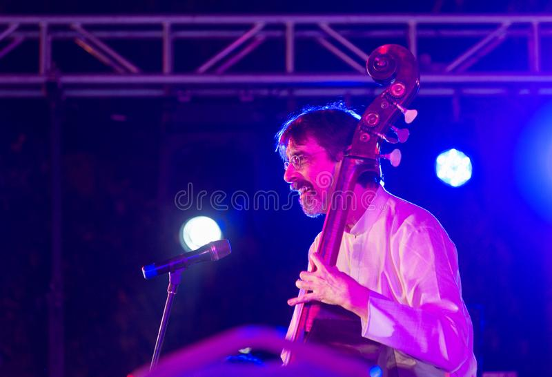 Bass musician Ritt Henn performing in India. Bangalore, India - February 10, 2018: American musician Ritt Henn plays bass as he performs onstage in Bangalore stock images
