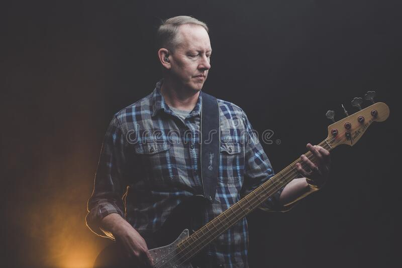 Bass player royalty free stock image