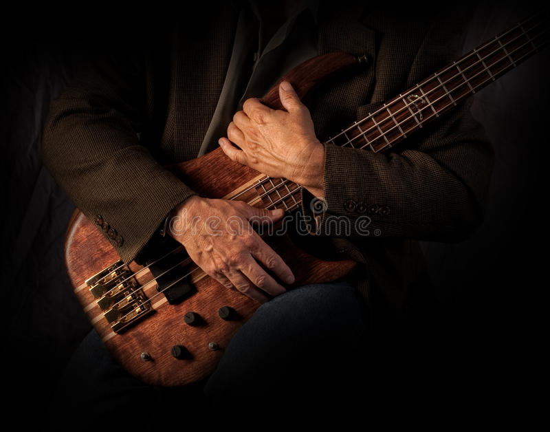 Bass Players Hands image stock