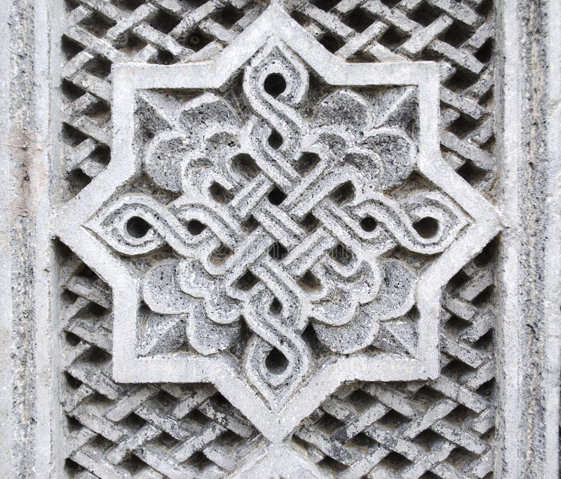 Bass-relief of the octagon with an ornament royalty free stock photos