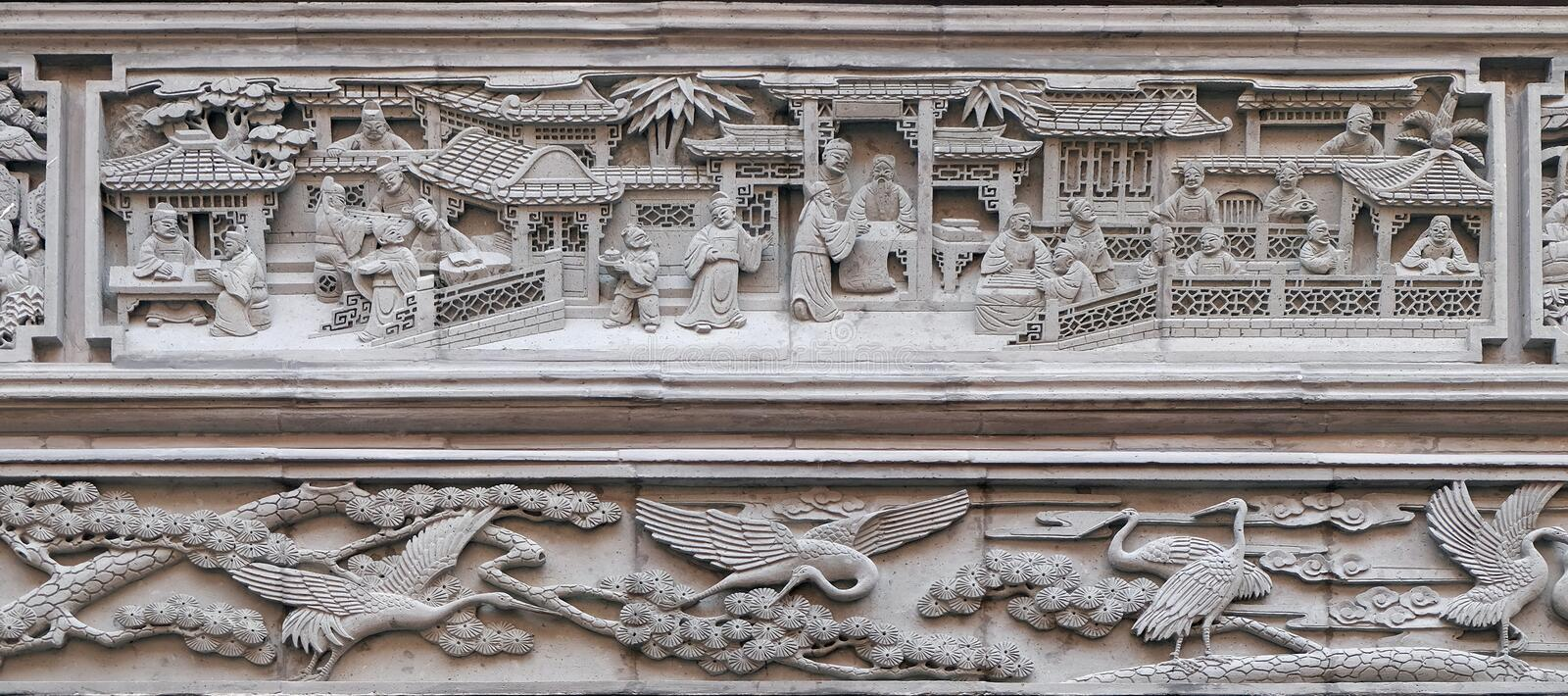 Bass-relief plaque on the doorway of the house in the Grand Canal, ancient town of Yuehe in Jiaxing, Zhejiang Province, China stock photo