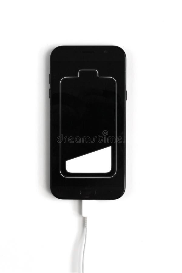 Basse icône blanche chargée de batterie dans l'écran de téléphone portable Chargement de batterie dans le mobile Concept d'?nergi illustration de vecteur