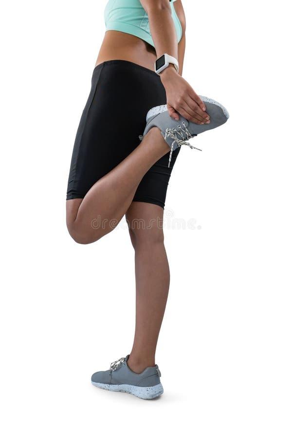 Basse section de l'exercice d'athlète féminin photos stock