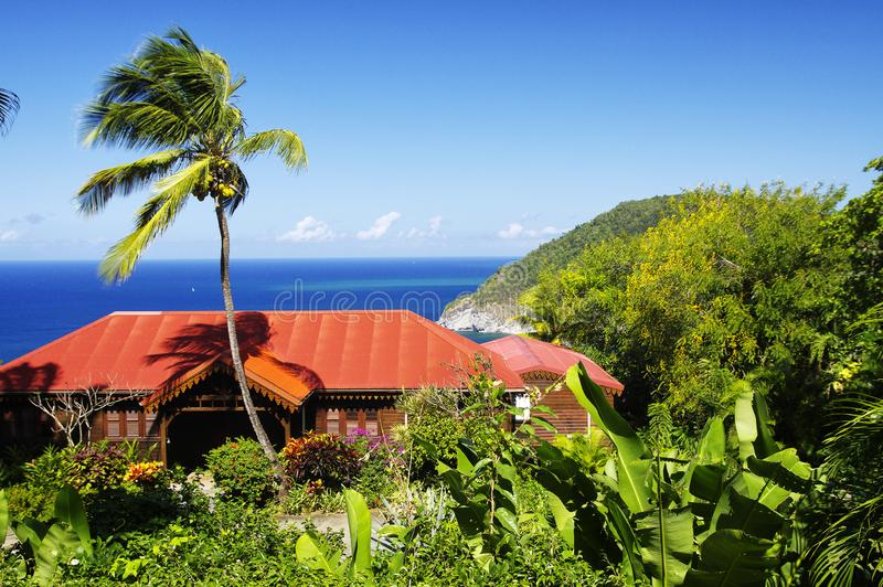 Beautiful colonial house with the spectalular view of the great bay at Deshaies, Basse-Terre, Guadeloupe royalty free stock images