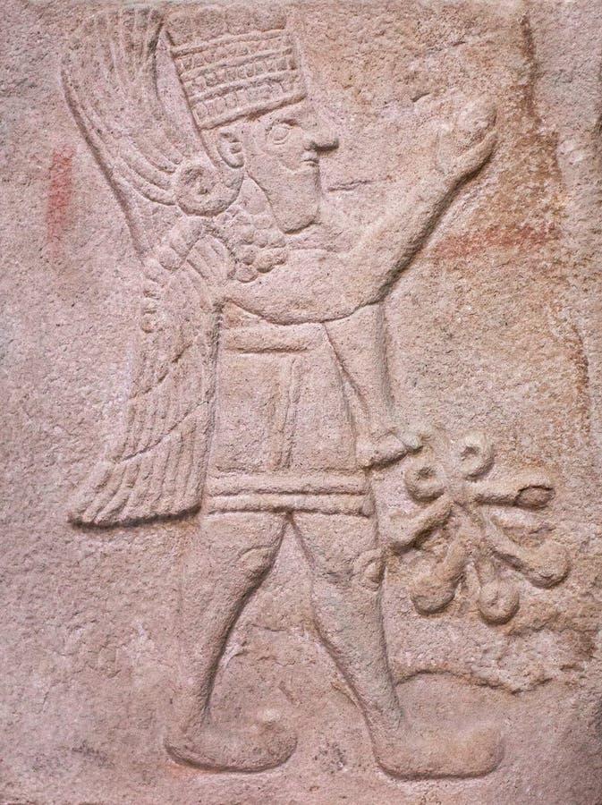Bassorilievo di pietra antico del periodo del Hittite del latte fotografie stock libere da diritti