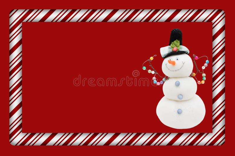 Bastão de doces com frame do boneco de neve ilustração royalty free