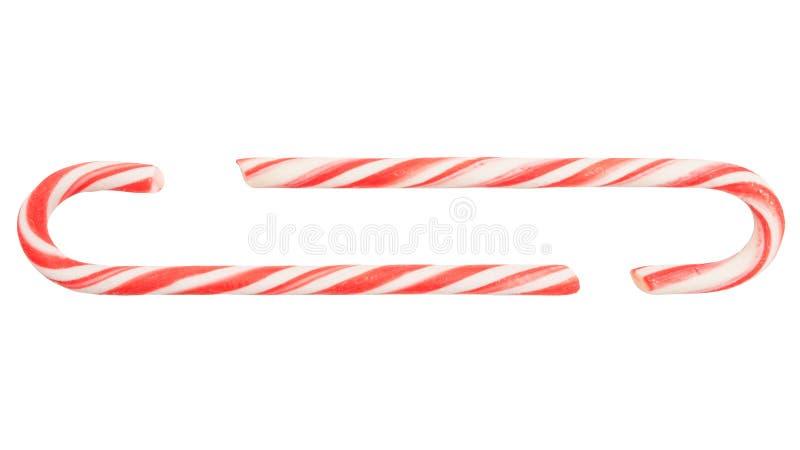 Bastão de doces tradicional do feriado dois listrado nas cores do Natal isoladas no fundo branco imagem de stock royalty free