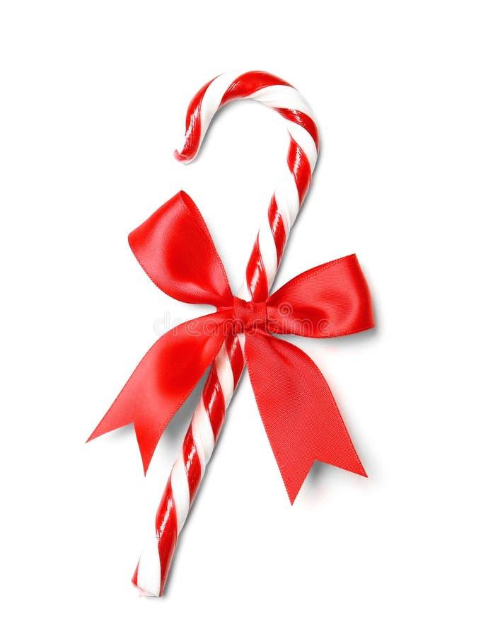 Bastón de caramelo de la Navidad con el arco aislado fotografía de archivo libre de regalías