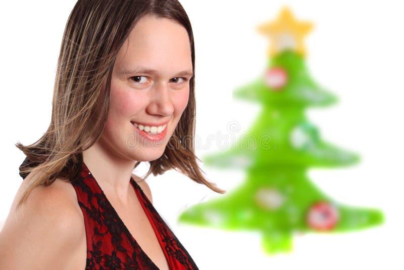 Bastante para arriba vestida muchacha adolescente de la Navidad foto de archivo