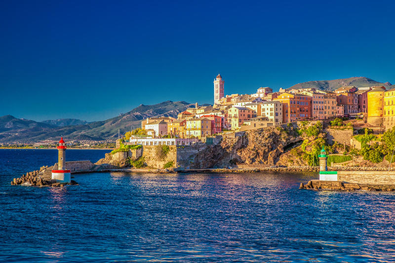 Bastia old city center, lighthouse and harbour, Corsica, France. View to Bastia old city center, lighthouse and harbour. Bastia is second biggest town on Corsica stock image
