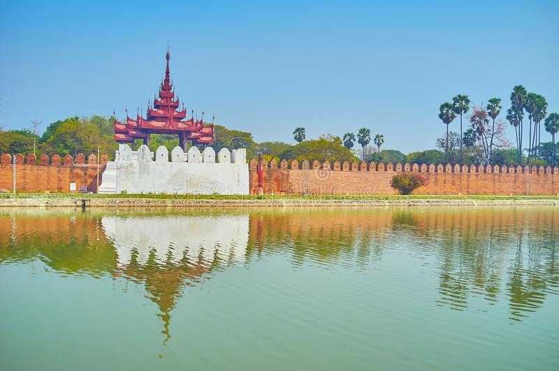 The bastion with watching tower, Mandalay, Myanmar. The bastions with oriental style watching towers were important defensive buildings, but nowadays they bring royalty free stock photos