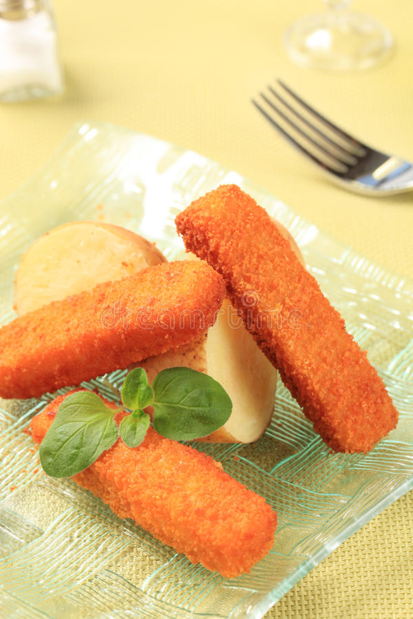 Bastoncini di pesci fritti fotografie stock