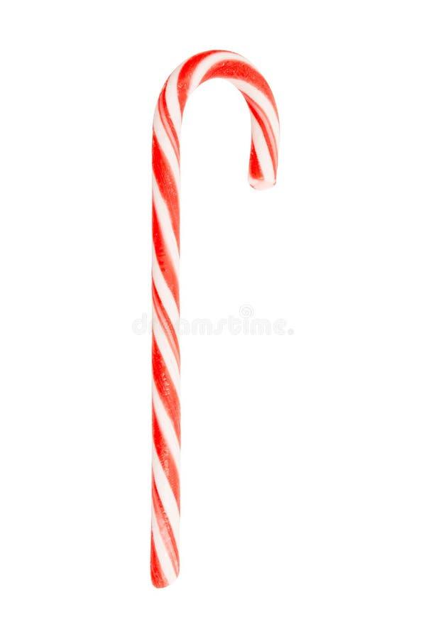 Bastoncino di zucchero tradizionale di festa barrato nei colori di natale isolati su fondo bianco immagine stock libera da diritti