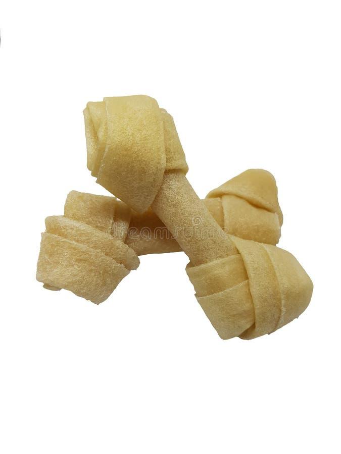 Bastone di masticazione dell'osso di cane Alimento del favorito del cane immagini stock