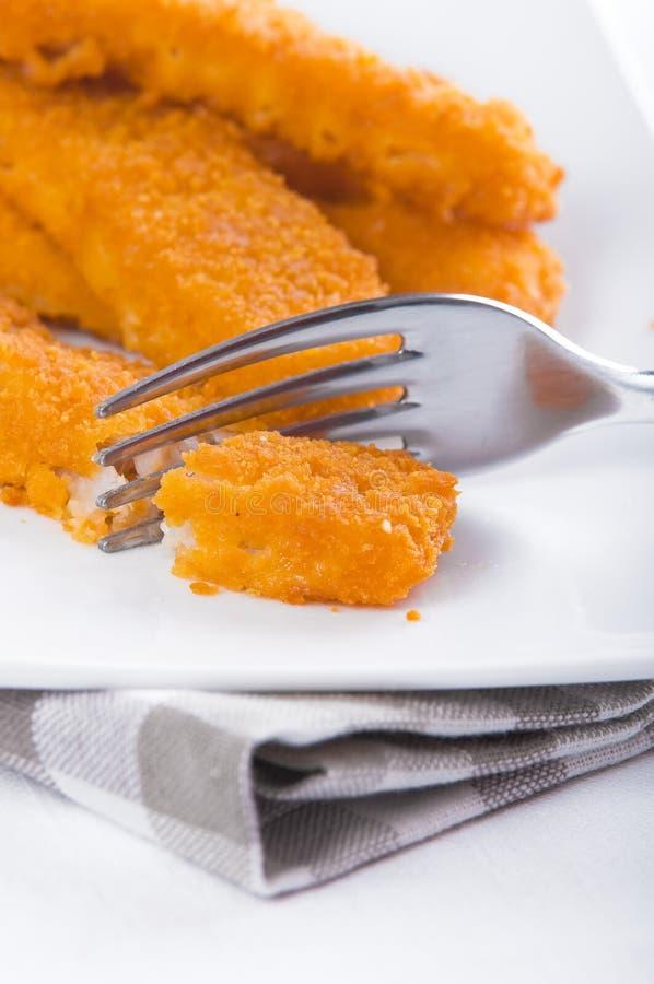 Bastoni di pesci fritti. fotografia stock