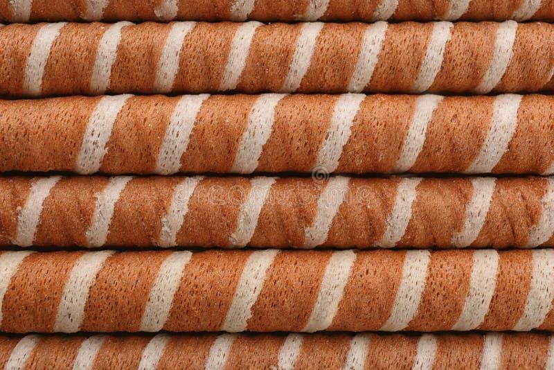 Bastoni saporiti del rotolo del wafer come fondo, vista superiore fotografia stock