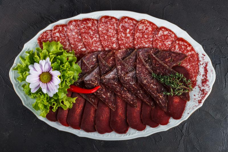 Basturma meat appetizer, sudzhuk and smoked sausage salami royalty free stock image