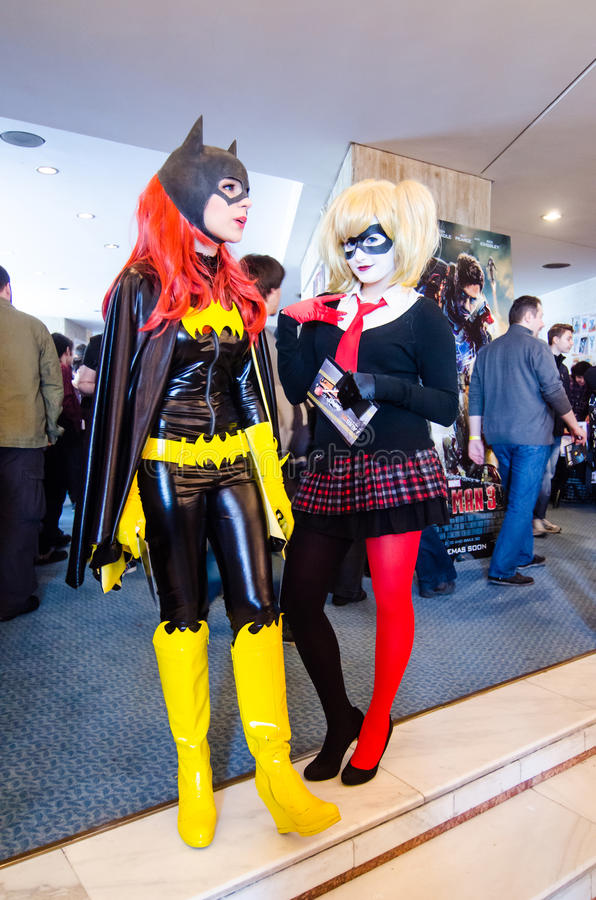 Bat Girl and Harley Quinn cosplayers. At East European Comic Con in Bucharest, Romania, 2013Bat Girls and Harlequin cosplayers stock photo