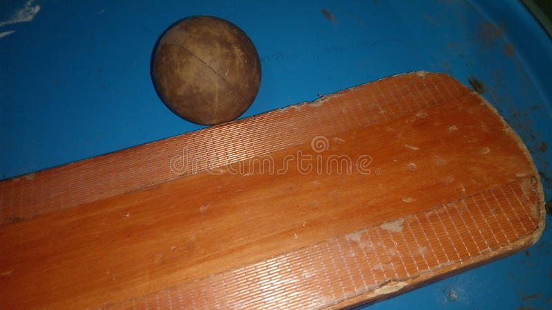 Bat with old ball stock photos