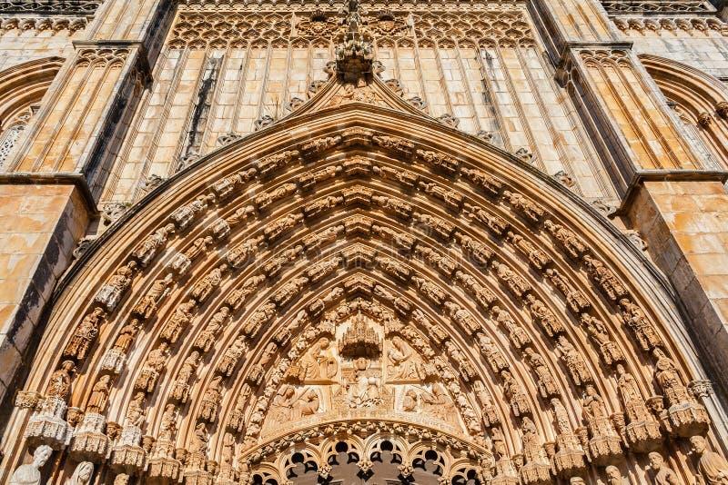 Batalha, Portugal. Close-up of the tympanum, archivolts and lintel of the Portal of Batalha Abbey aka Monastery of Santa Maria da royalty free stock photography
