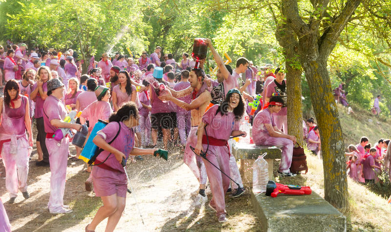 Batalla del vino - wine madness in Haro. HARO, SPAIN - JUNE 29, 2014: Batalla del vino - wine madness in Haro, Spain. People pour wine at each other during royalty free stock photo