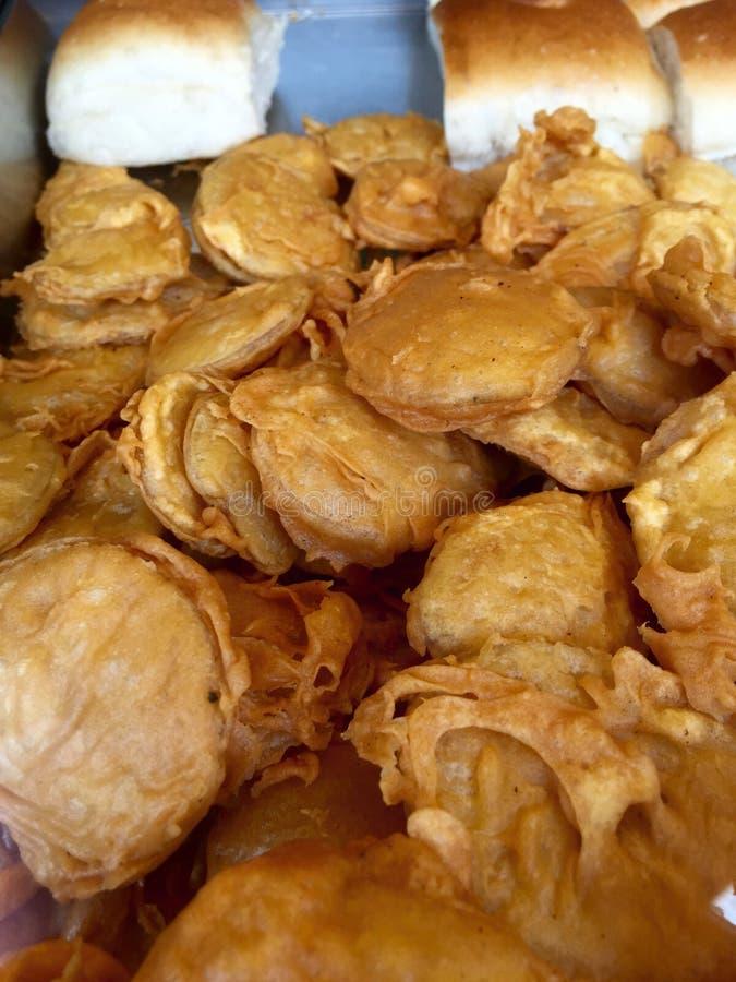 Batata bhajji or potato fritters - Indian fast food. Aloo pakora also known as aloo bajji or batata bhajia or potato fritters. It has crispy layer on outside and stock photo