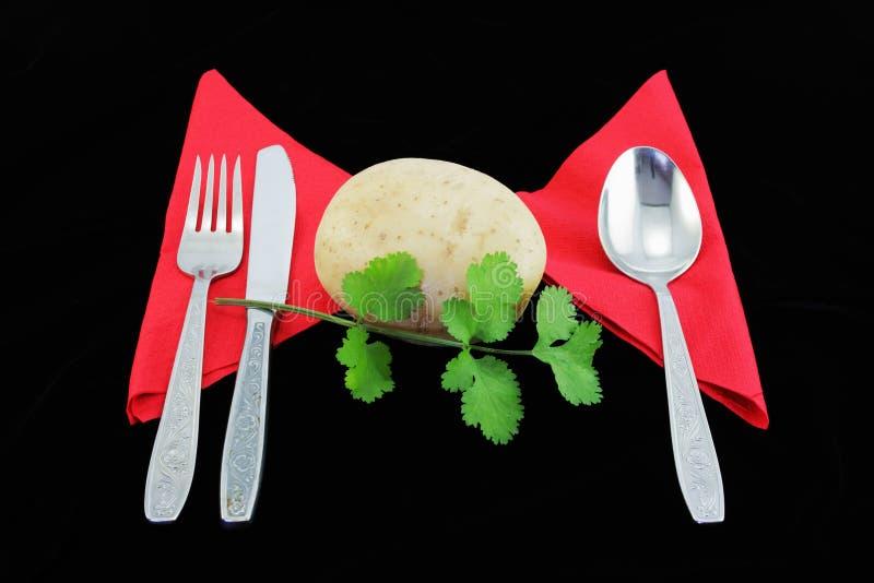 Batata com flatware. imagem de stock
