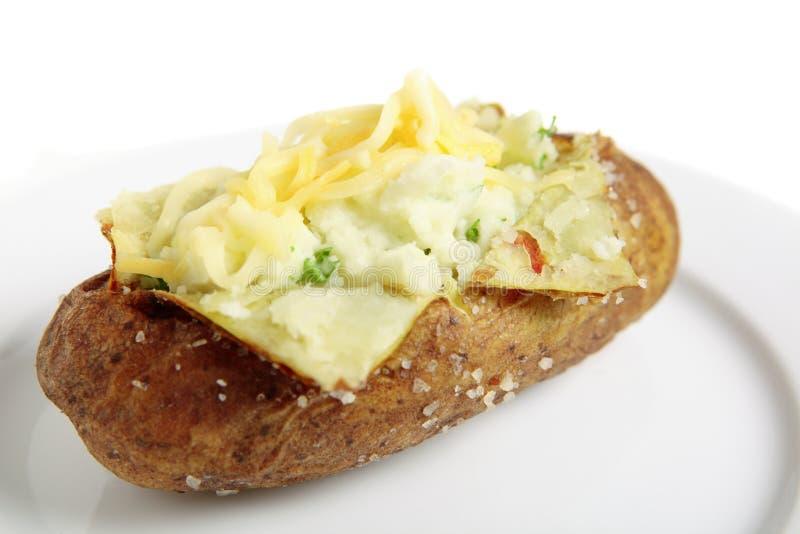 Batata cozida com queijo imagem de stock