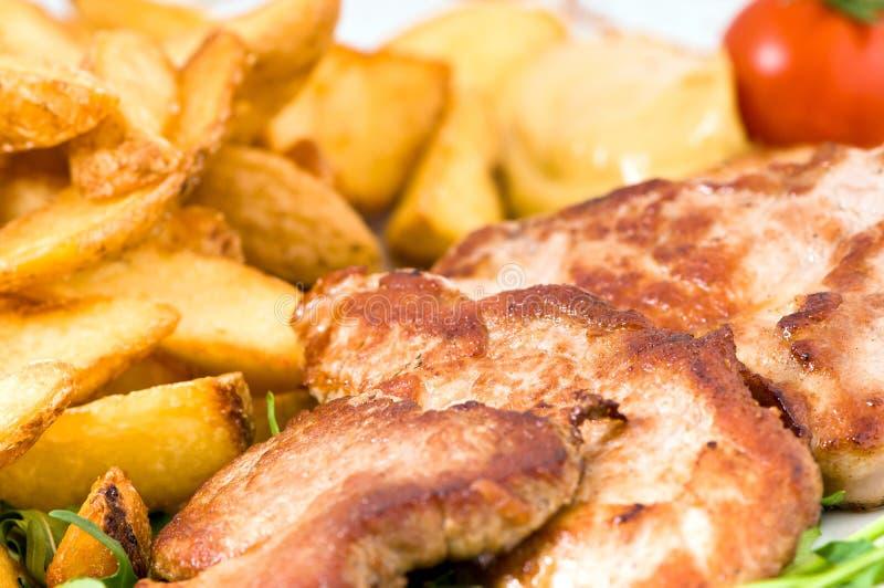 Batata e carne de porco foto de stock