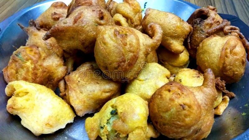 Batata Wada. A closeup click of potato based fresh and fried batata wada snack in a pan royalty free stock photos