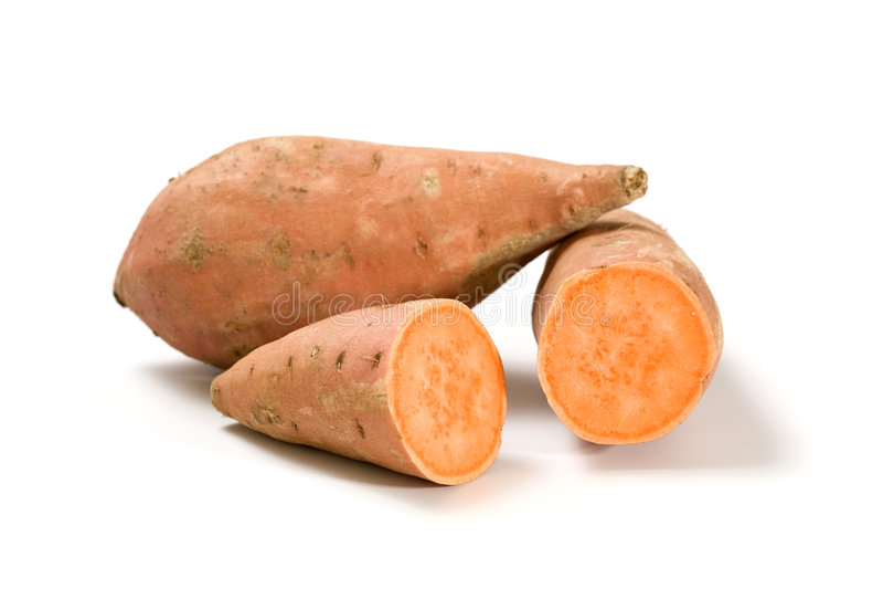 Batatas doces inteiras e halved imagem de stock royalty free
