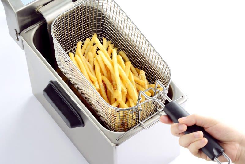 Batatas fritadas imagens de stock