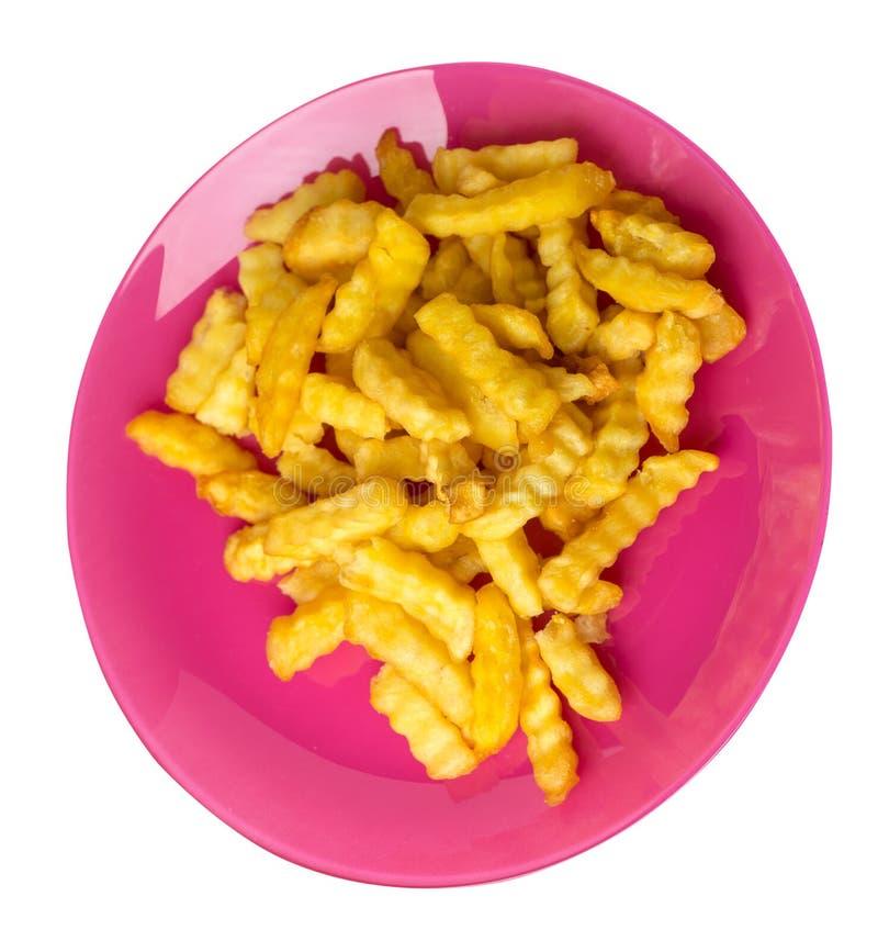 batatas fritas em uma placa isolada no fundo branco batatas fritas em uma opinião superior da placa Comida lixo fotos de stock